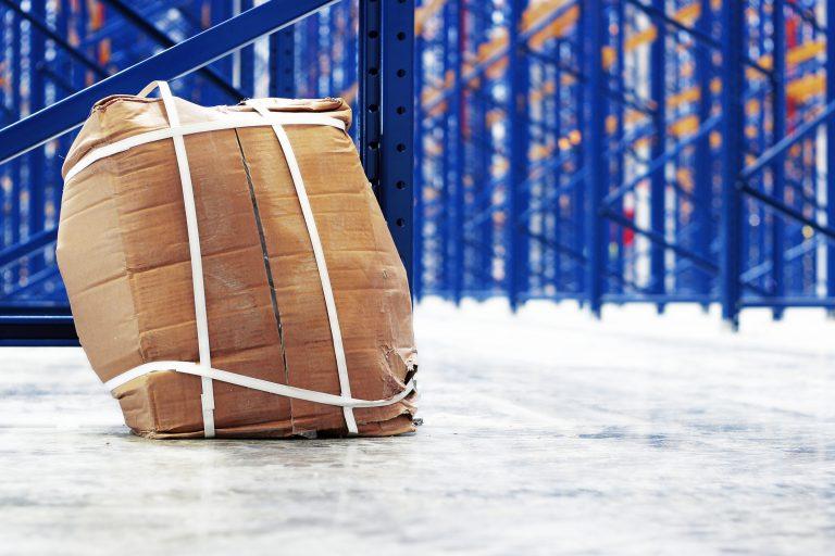 Unsafe cardboard box bulging under stress