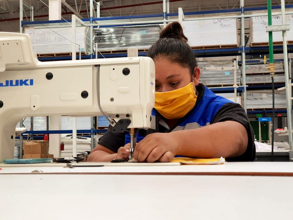 Schaefer employee sewing face masks