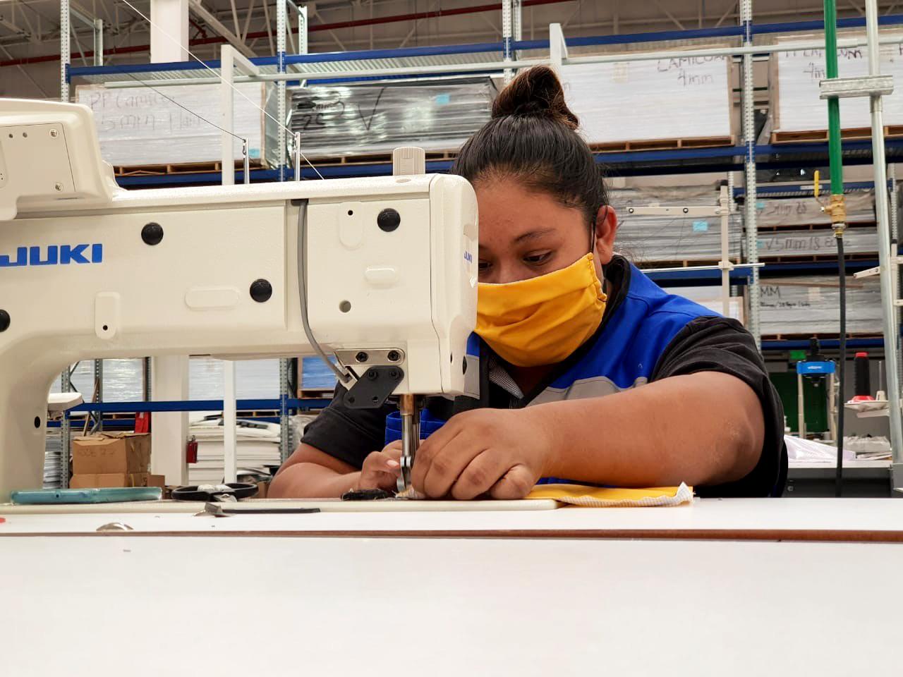 Schaefer employee sewing face masks